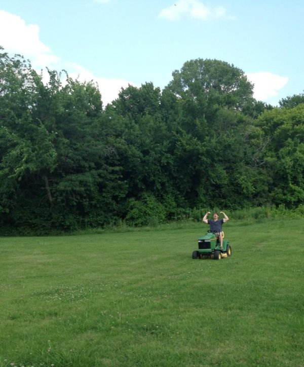 Happy Man Mowing